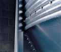 HYDROSHIELD® Weather Guard  directs moisture away from the bin's hopper and boot area.