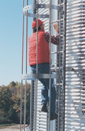 Ladder Safety Cage is standard for ladders on bins with an eave height of over 20 feet (6.1 meters).