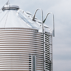 Brock's Feed Bin Ladder System includes a sturdy, patented handrail at the top for climbing convenience.